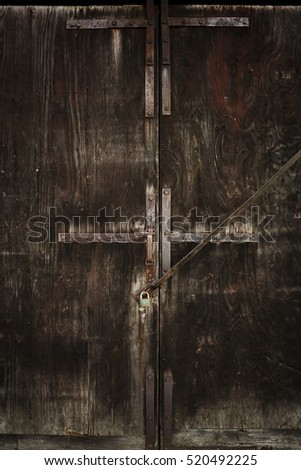 Scary looking old wooden door with lock