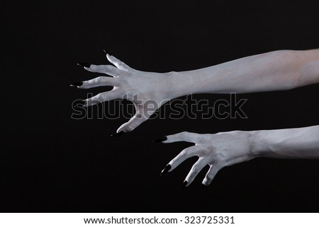 Scary pale ghost hands with black nails, body art for Halloween  - stock photo