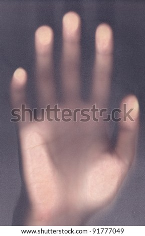 scary palm of hand behind shower curtain background - stock photo