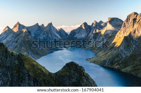 Scary peaks of Lofoten mountain ridge at sunset, Norway - stock photo