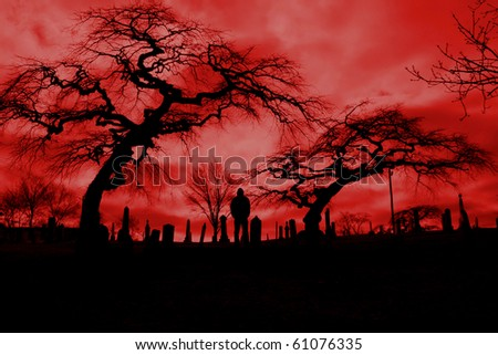 Scary pic of cemetery with hellfire sky and scary trees.  Perfect for Halloween or horror themes. - stock photo
