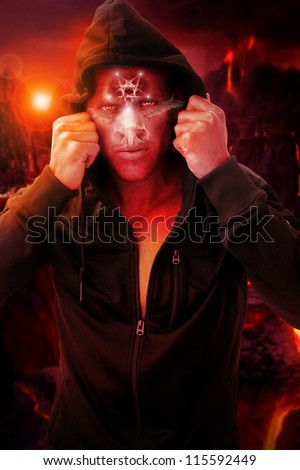 Scary portrait of a devil figure in hell background - stock photo