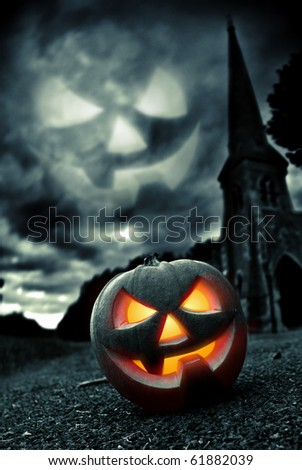 Scary Pumpkin within a graveyard... - stock photo