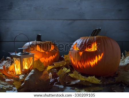 Scary pumpkins jack o lantern on wooden fence  - stock photo