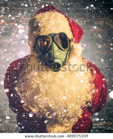 Scary Santa Claus with gas mask and snow in background,blank space