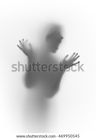 Scary screamer face silhouette, hands, fingers, head behind a curtain