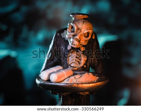 Scary skeleton zombie holding a tray with pills. Mystic fear, the dark forest. About the dangers of drugs. Drugs, addiction, death