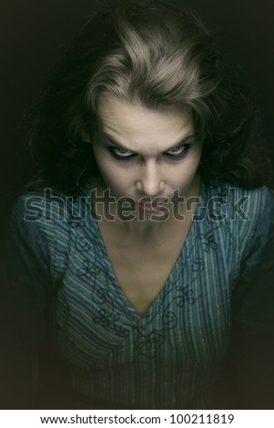 Scary spooky evil woman in the dark - stock photo