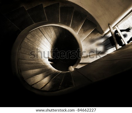 Scary stairs with scary face looking in the window - stock photo