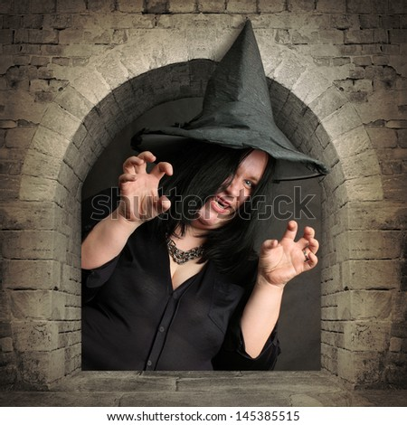 Scary witch rising from the vault. Halloween theme. - stock photo