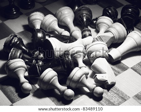 Scattered chess on a board. Black & white. Artistic noise. - stock photo