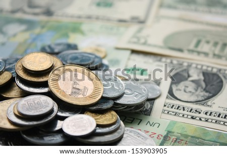 Scattered coins - stock photo