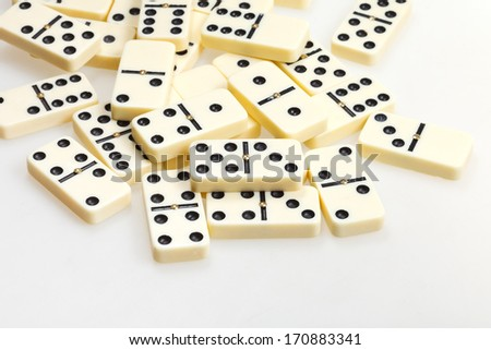 scattered dominoes on white background close up
