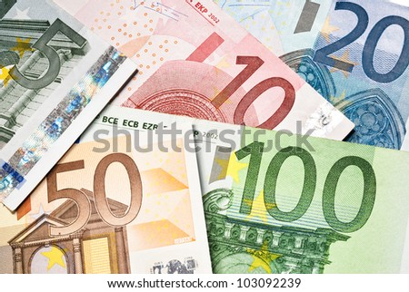 scattered euro currency banknotes close up - stock photo