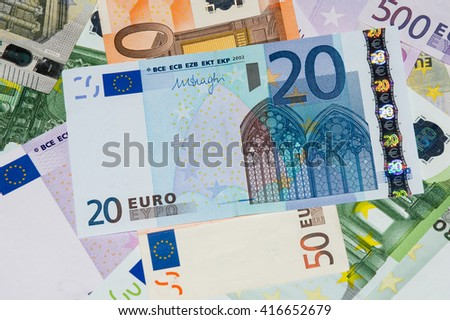 Scattered euro currency banknotes, closeup view