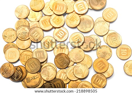 Scattered golden coins with Israeli symbols  - stock photo
