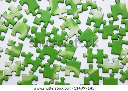 scattered green puzzle, background - stock photo