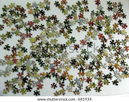 Scattered jig-saw pieces - stock photo