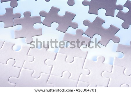 Scattered jigsaw puzzle peaces