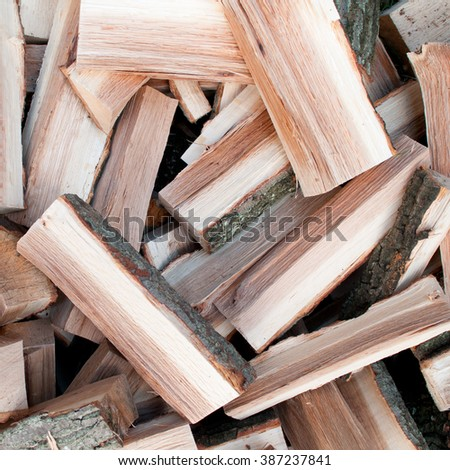 Scattered logs of oak tree for making a fire - stock photo