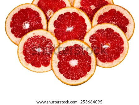 scattered on top fresh grapefruit slices, can be used as a background, isolated on a white - stock photo