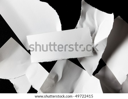 Scattered pieces of torn paper, center piece for adding a message - stock photo