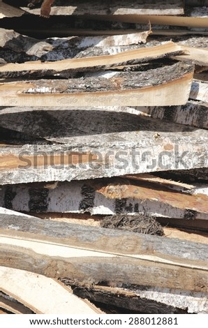 Scattered planks. Material for building a house.