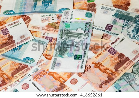 Scattered ruble currency banknotes, closeup view