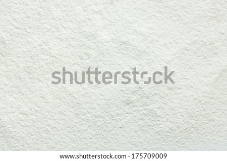 Scattered wheat flour on table as background or texture - stock photo