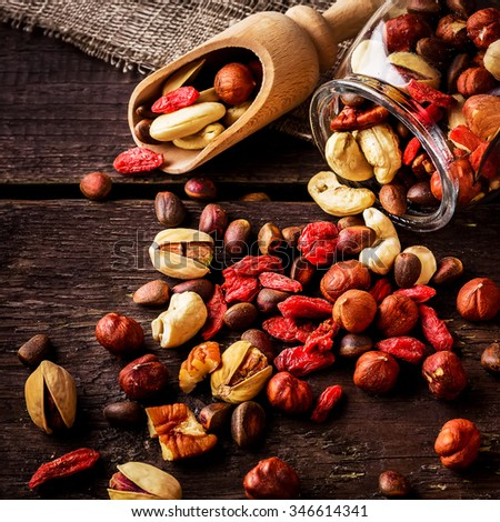 Scatterede nuts  and shovel. Wooden background,selective focus.  - stock photo