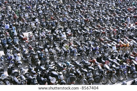 scene at parking lot in chandni chowk, old delhi,  india - stock photo