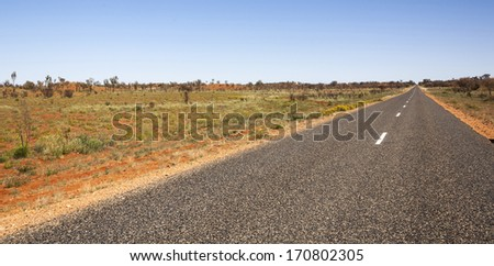 scene from inland australia flat country side endless road - stock photo