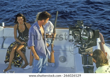 Scene from set of 'Temptation' on yacht with guns, feature film, Miami, FL - stock photo