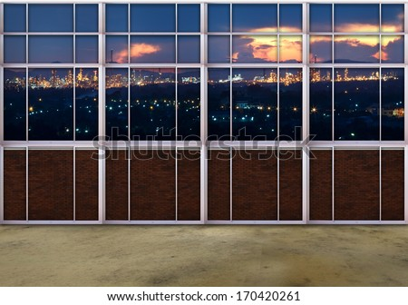 scene from window view of heavy industry estate with beautiful dusky dramatic sky and light of factory plant - stock photo