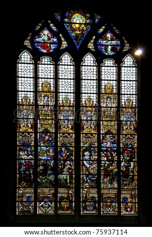 Scene in stained glass church window - stock photo