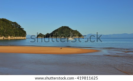Scene in the Abel Tasman National Park, New Zealand. Onetahuti Bay and Tonga Island. Sandy beach. - stock photo