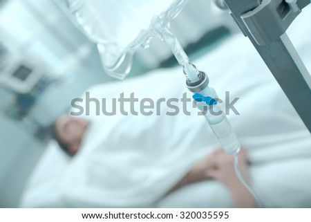 Scene in the hospital with a fragment of medical equipment and patient sufferer - stock photo