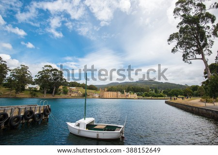 Scene of a dock with a small boat at Port Arthur, Tasmania - stock photo