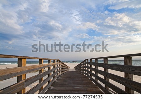 Scene of a walkway leading to the beach at Orange Beach AL.