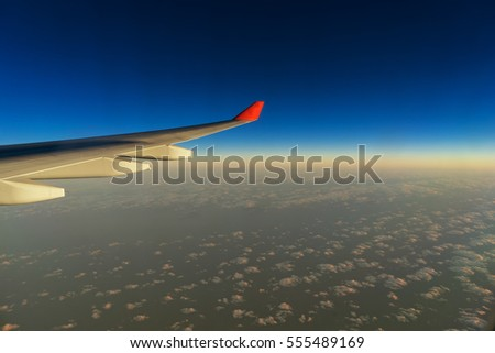 scene of airplane wing on the blue sky with cloudscape - can use to display or montage on product