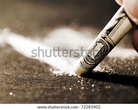 Scene of drugs addiction sniffing through a bill - stock photo