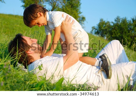 Scene of family happiness on beautiful green meadow - stock photo