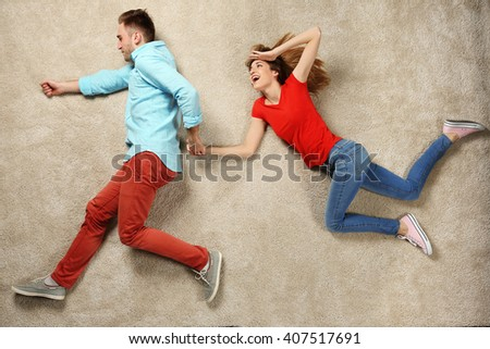 Scene simulation, young couple running and jumping - stock photo