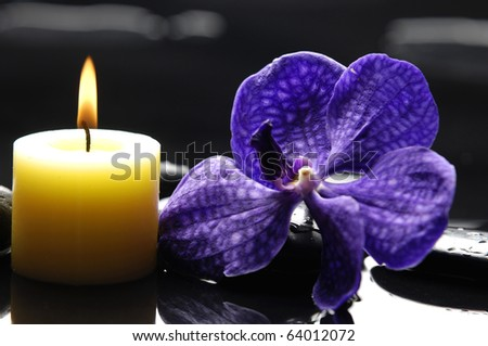 Scene with burning spa candles with macro of orchid - stock photo