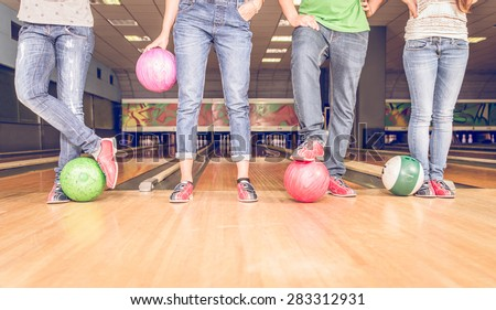 scene with four people and bowling balls. concept about bowling, fun and leisure. floor view - stock photo