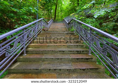 scene with stairs in rainy park - stock photo