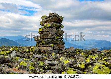 scene with stone pile on mountain top in Ukrainian Carpathian