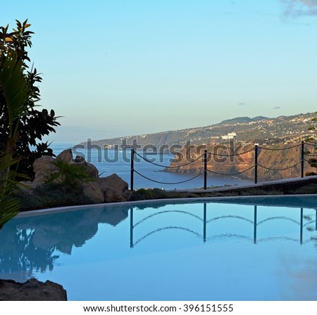 Scene with swimming pool and tropical vegetation.Canary Islands.Spain.