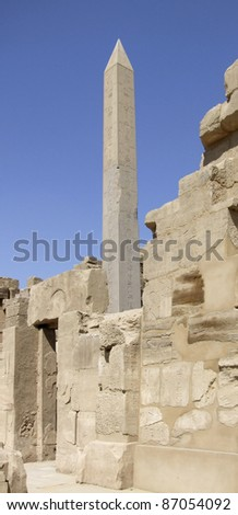 scenery around Precinct of Amun-Re in Egypt showing a obelisk and stone ruins