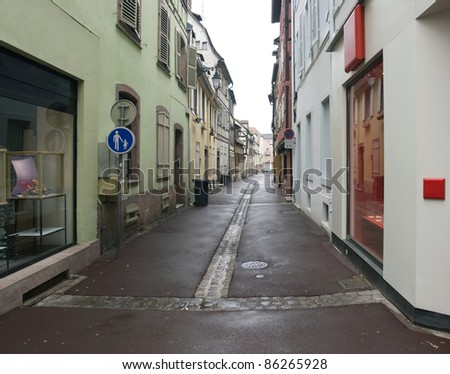 scenery in Colmar showing a small street (Alsace/France) - stock photo